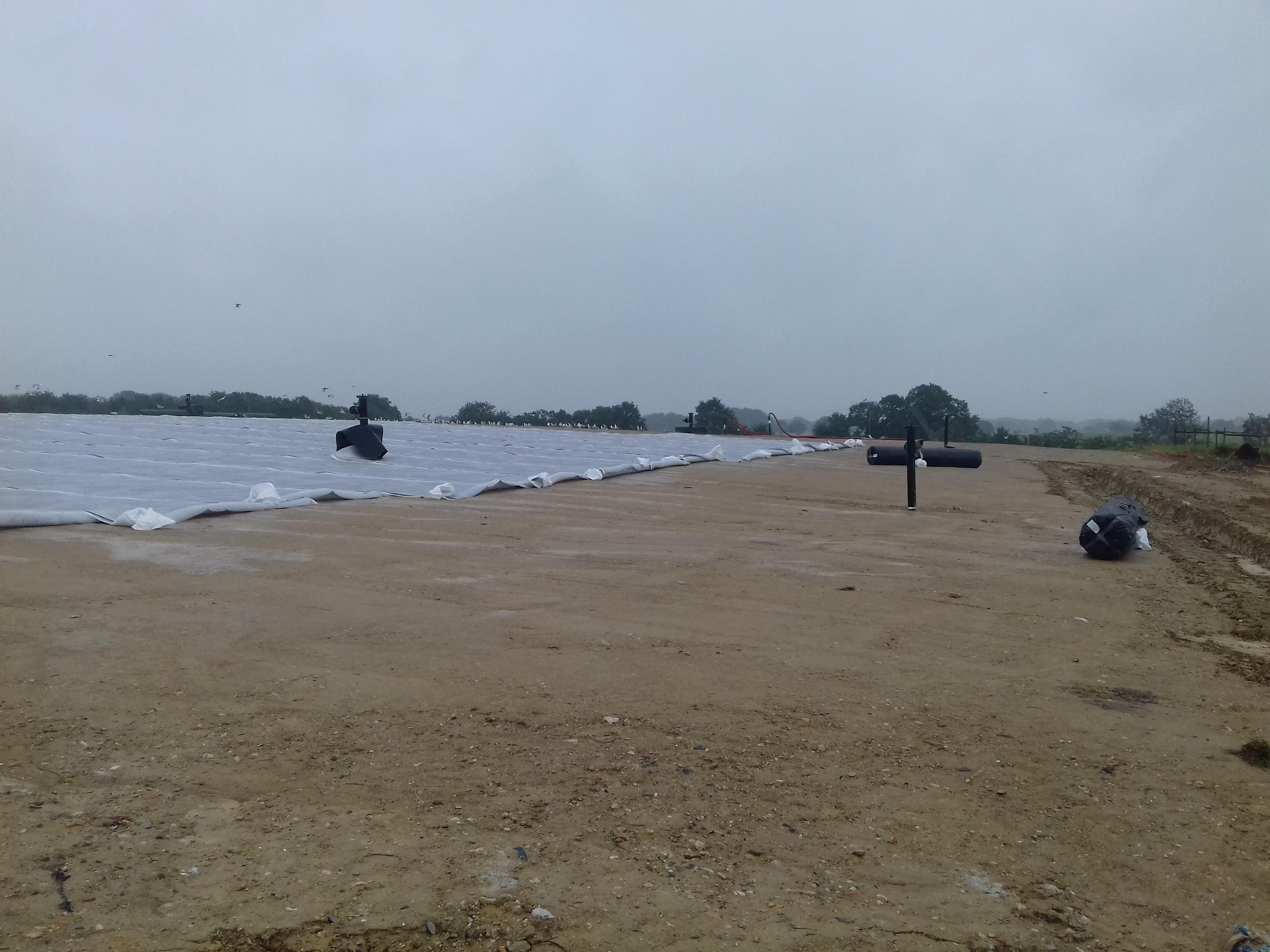 Fermeture : Mise en place géocomposite de drainage des eaux pluviales
